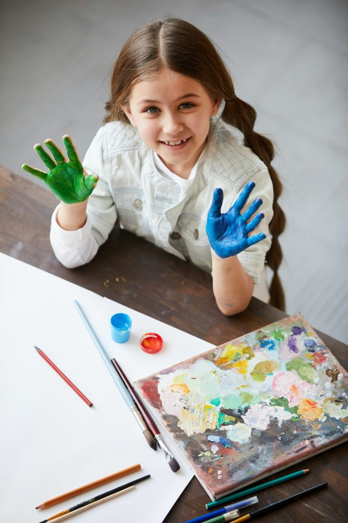 Cute Girl Enjoying painting